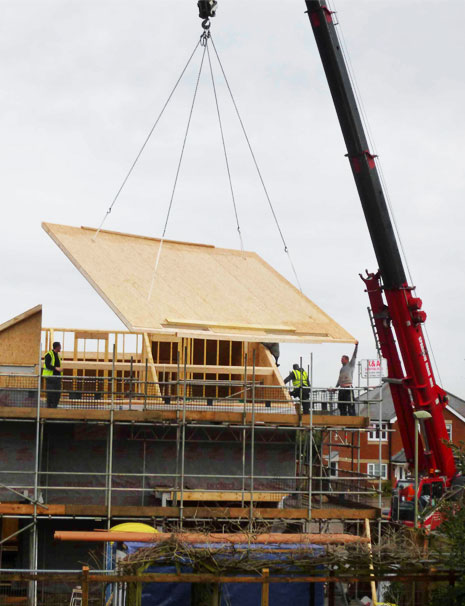 SIPs house being craned into position